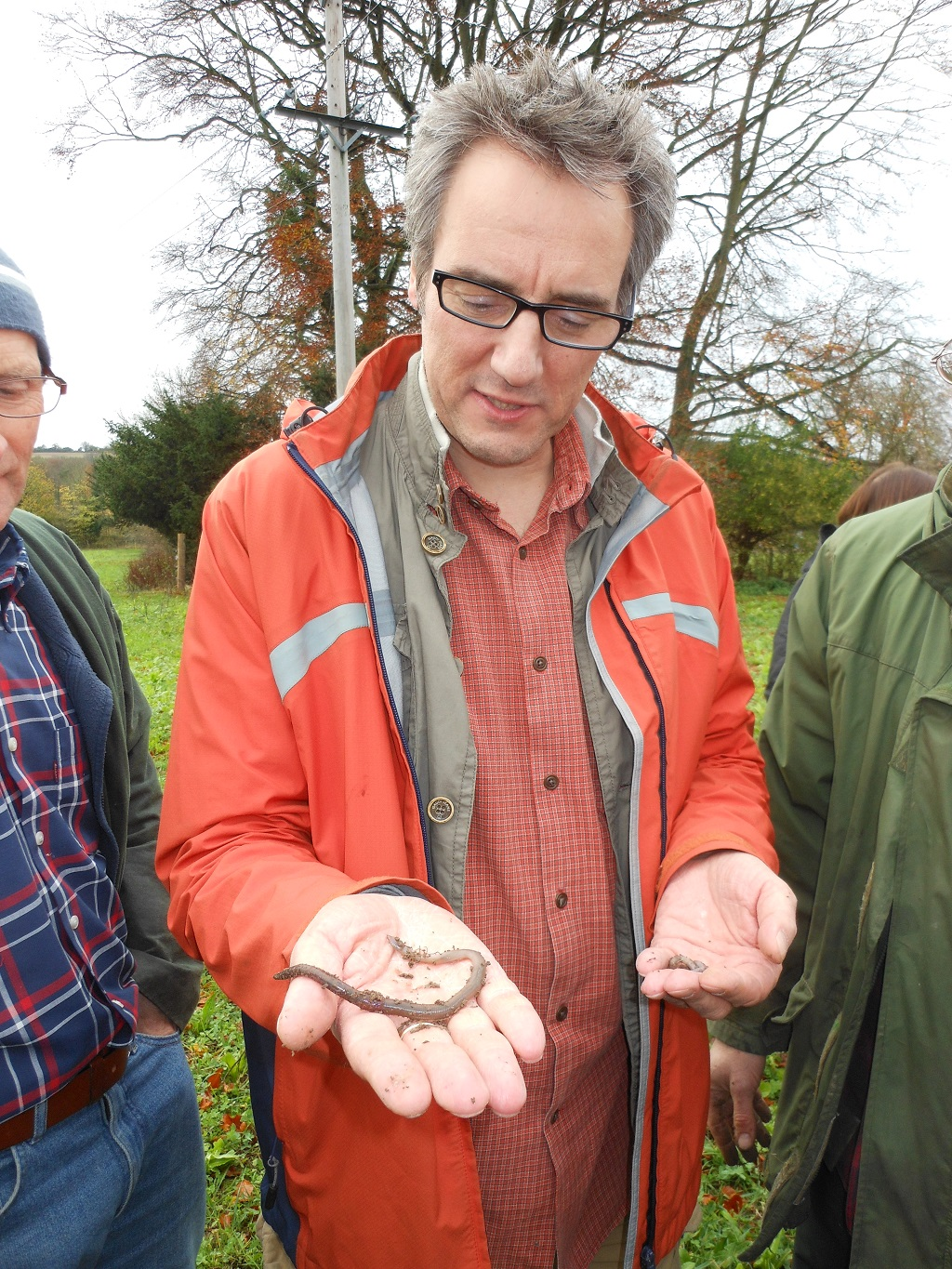 Dr David Jones (The British Museum) explaining speaking to farmers at a CSF event in Wiltshire how earth worms play a significant role in keeping soils healthy.