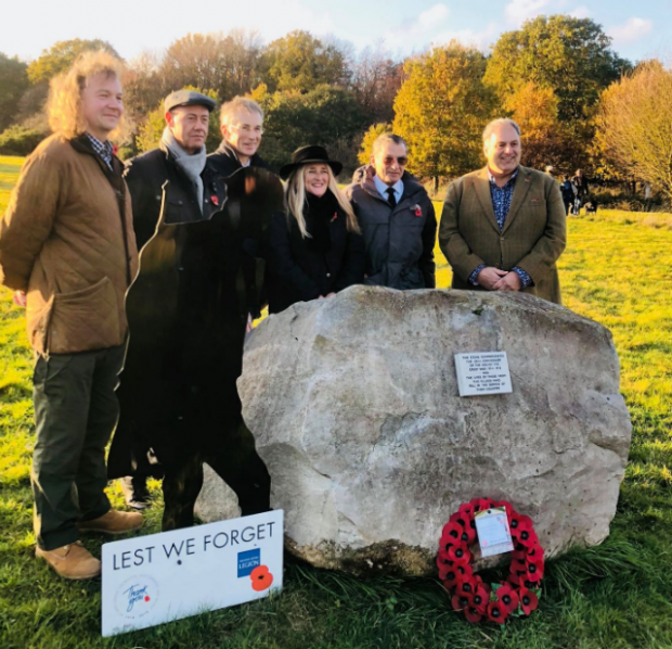Councillors standing behind a First World War memorial stone at Aston Rowant National Nature Reserve