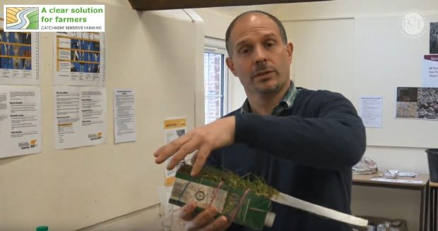 Natural England soils expert demonstrating a soils experiment