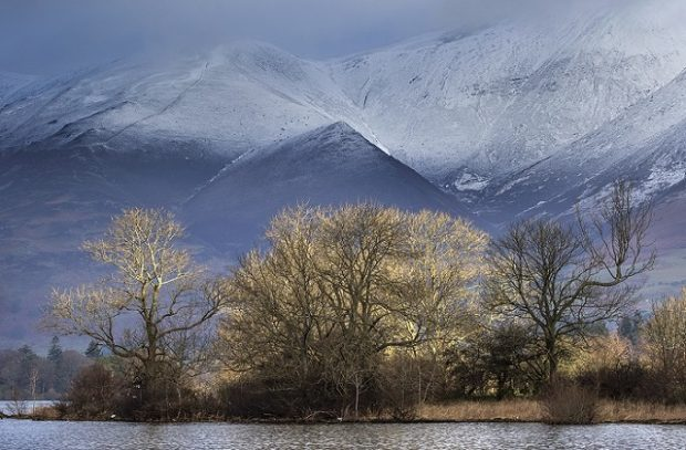 An image of Lake District National Park from across the lake