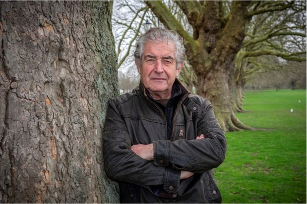 Tony Juniper leaning against a tree